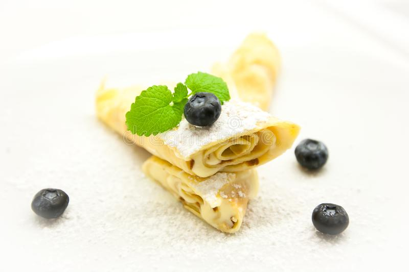 Delicious Tasty Homemade crepes or pancakes with blueberries. stock images