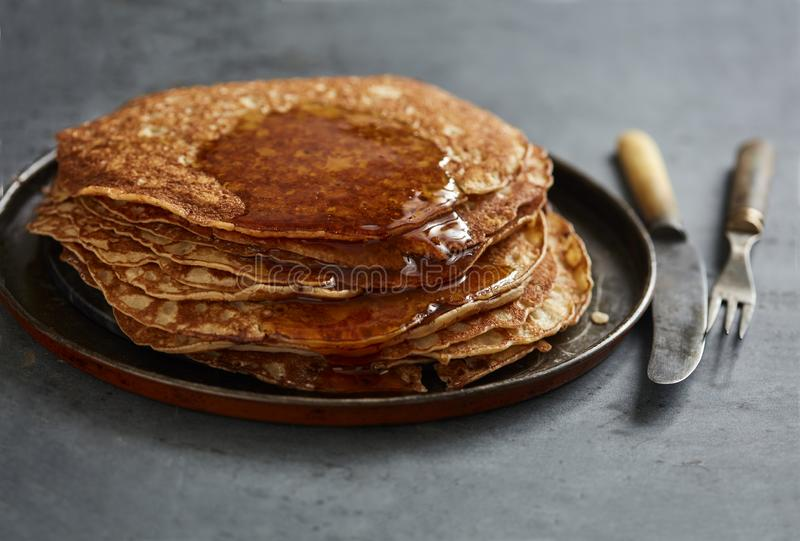 Crepes with maple syrup stock photo