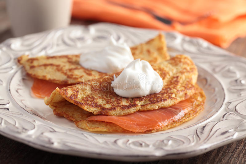 Crepes with salmon royalty free stock images