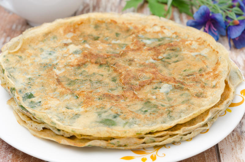 Crepes with spinach royalty free stock photos
