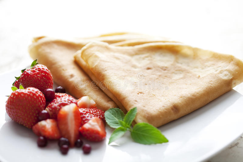 Crepes with strawberries stock photography