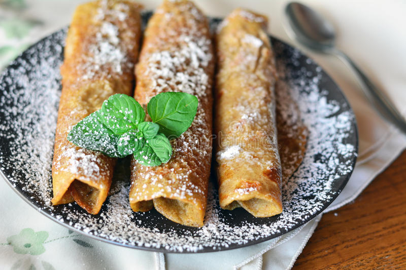 Crepes With Strawberry Jam On The Brown Plate. Pancakes. royalty free stock photo