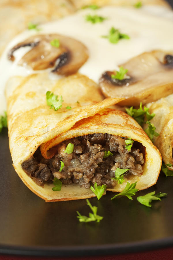 Crepes Stuffed with Mushrooms Pancakes royalty free stock photos
