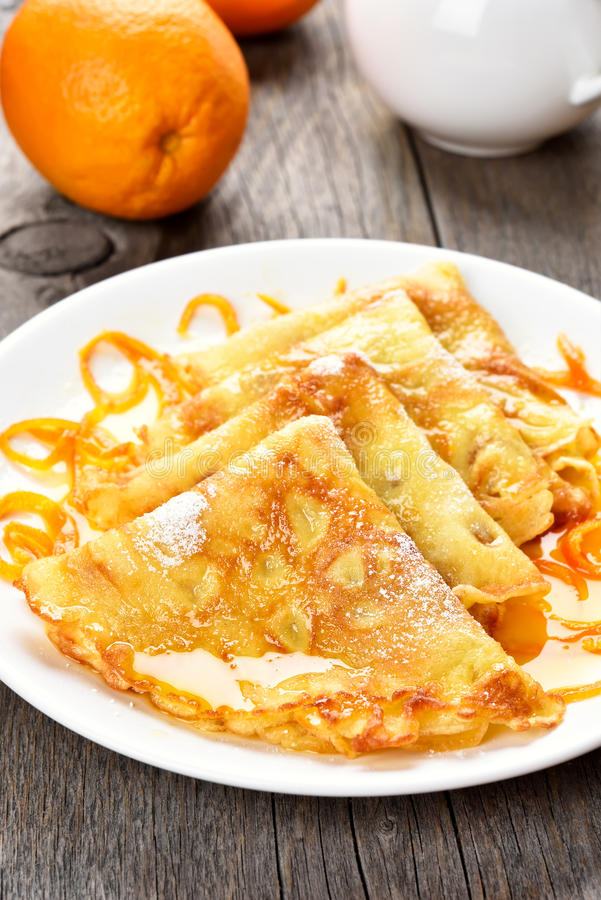 Crepes Suzette on white plate royalty free stock image