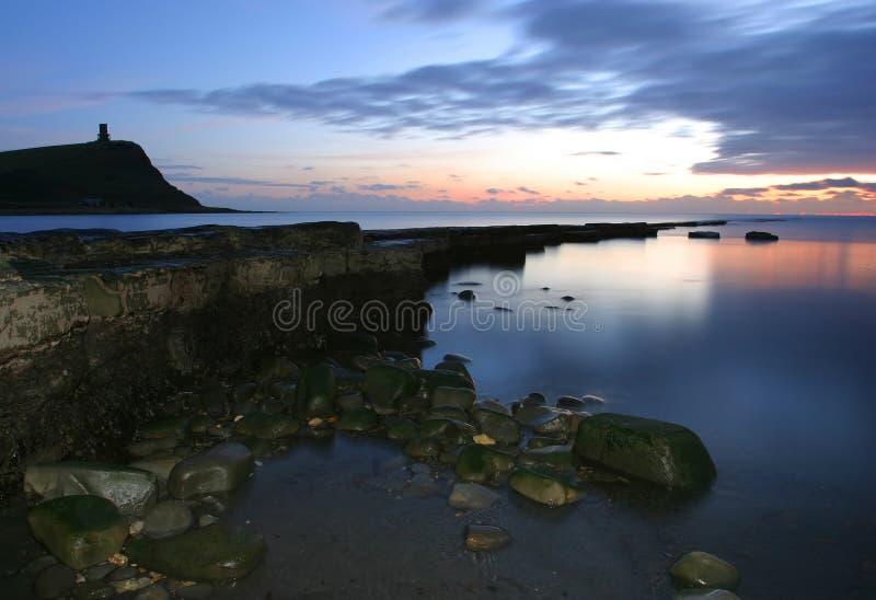 Crepuscolo alla baia di Kimmeridge fotografie stock