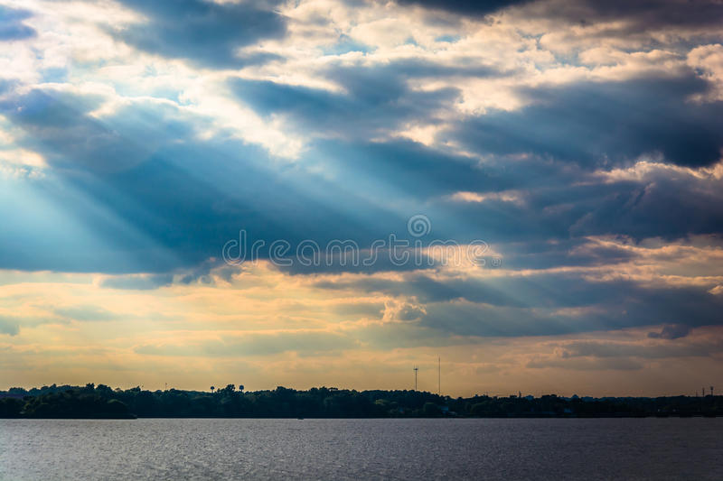Crepuscular rays over the Back River seen from Cox Point Park, E royalty free stock photos