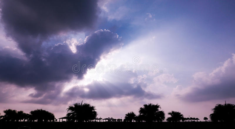 Crepuscular rays. These crepuscular rays stream through gaps in clouds stock photos
