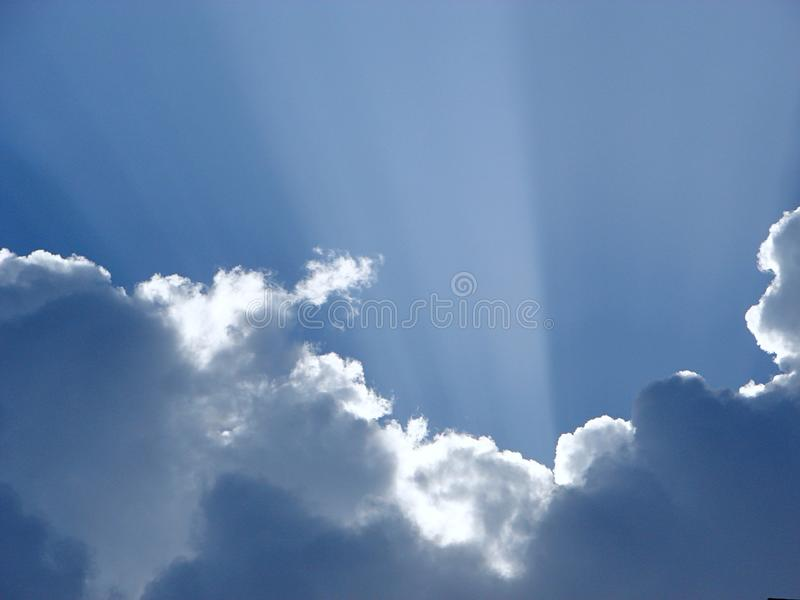 Crepuscular Sun Rays from Clouds with silver lining stock image