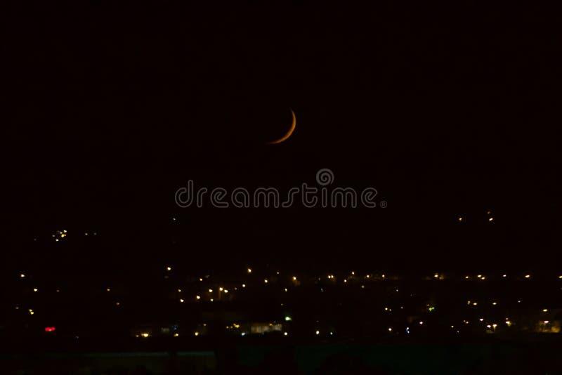 Crescent Blood Moon Over City imagens de stock royalty free