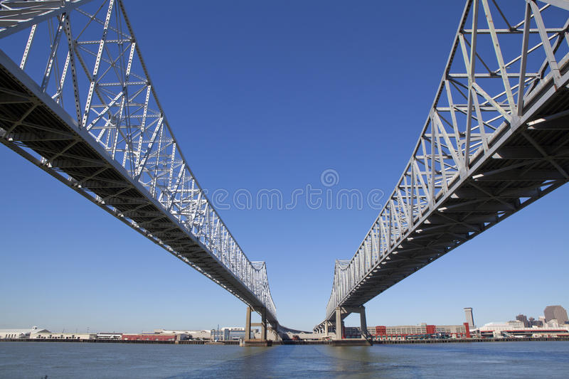 Crescent City Connection - New Orleans, Louisiana. Crescent City Connection (twin cantilever style bridges) which is U.S. Route 90 going over levee (levy) and royalty free stock image