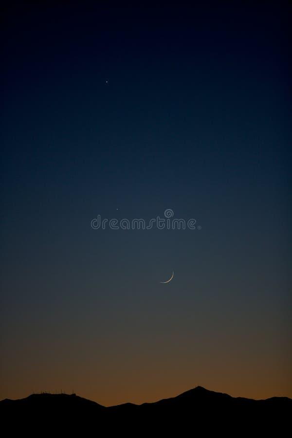 Crescent desert moon stock images