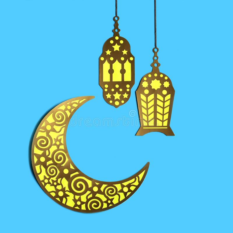 Crescent and hanging lanterns for Ramadan stock image