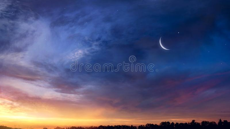 Crescent moon with beautiful sunset background . Generous Ramadan royalty free stock images