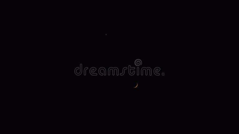 Crescent Moon con una estrella sobre ella, en cielo nocturno del negro oscuro, la India foto de archivo libre de regalías