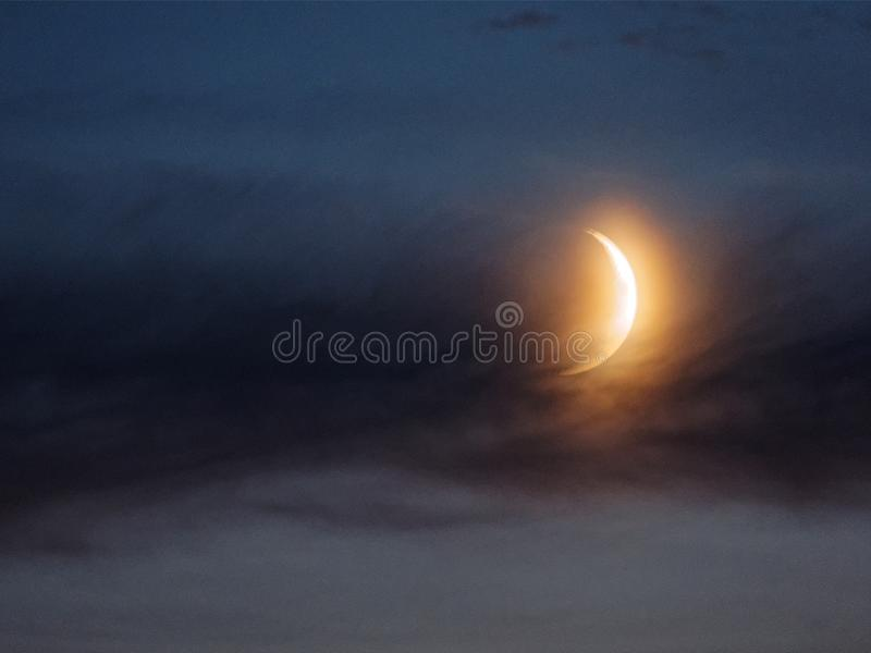 Crescent moon. Over my hometown royalty free stock photo