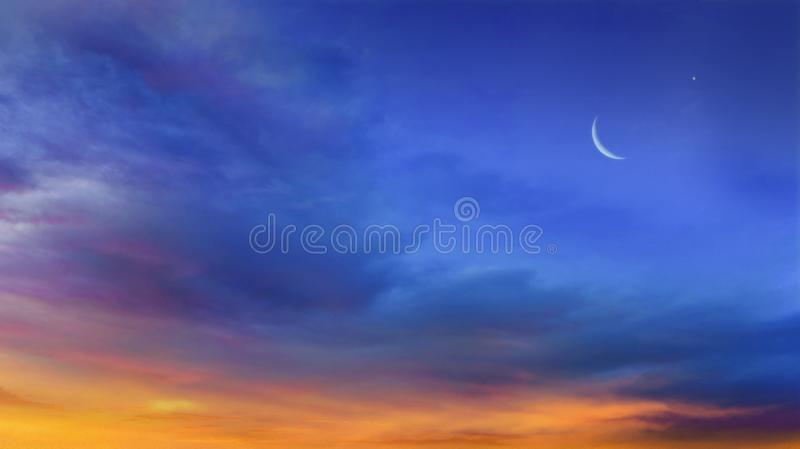 Crescent moon with Stars . Crescent moon with beautiful sunset background . Generous Ramadan royalty free stock images