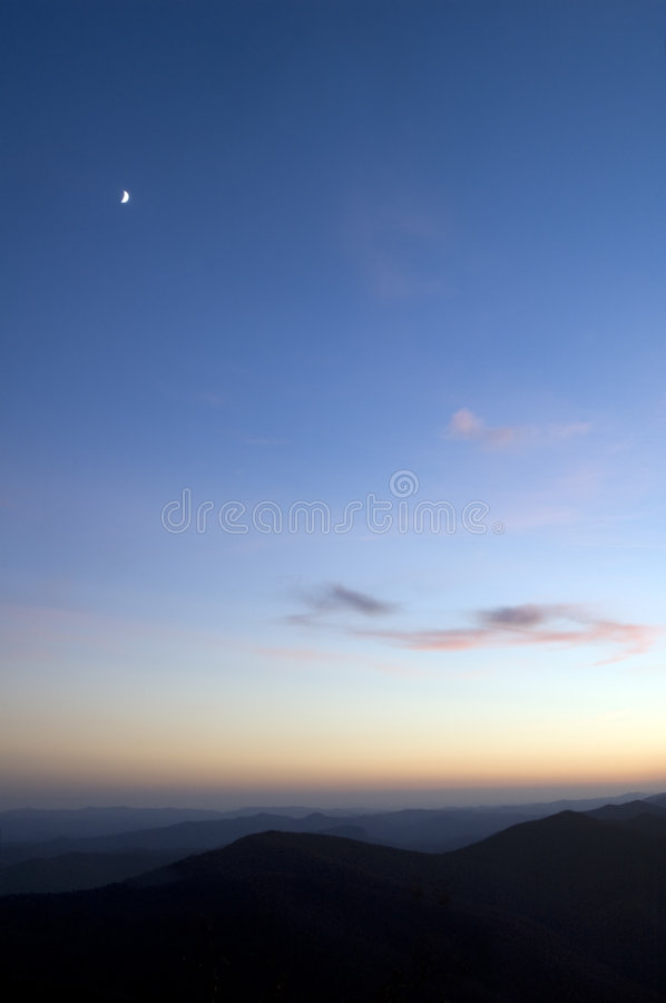Crescent moon sunset. Crescent moon and sunset over beautiful blueridge mountains royalty free stock images