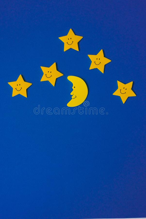 Crescent moon and yellow stars against the blue night sky. Application paper. Copy space stock images