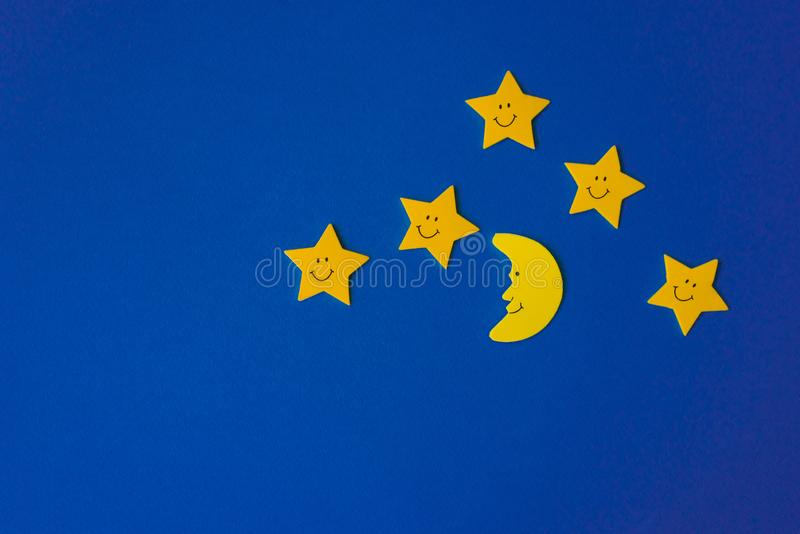 Crescent moon and yellow stars against the blue night sky. Application paper. stock photography