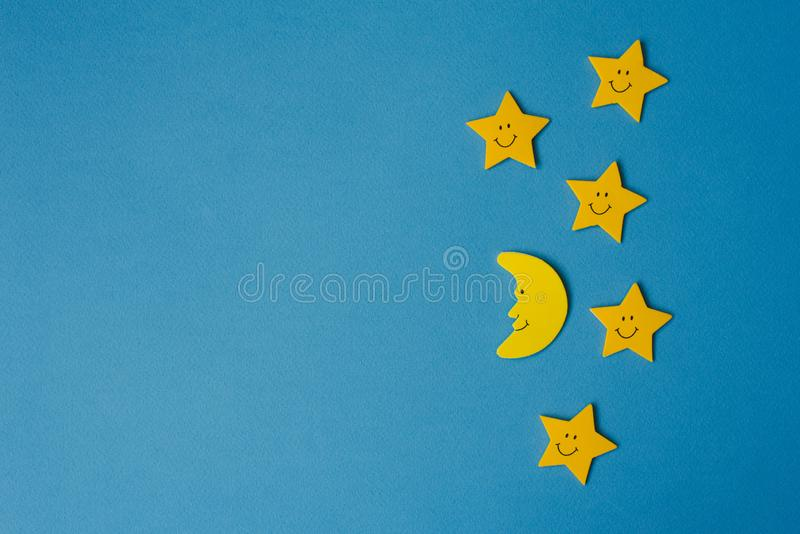 Crescent moon and yellow stars against the blue night sky. Application paper. Copy space stock photography