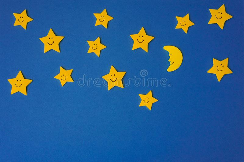 Crescent moon and yellow stars against the blue night sky. Application paper. Copy space royalty free stock images