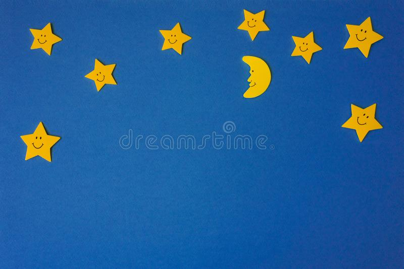 Crescent moon and yellow stars against the blue night sky. Application paper. Copy space stock photo
