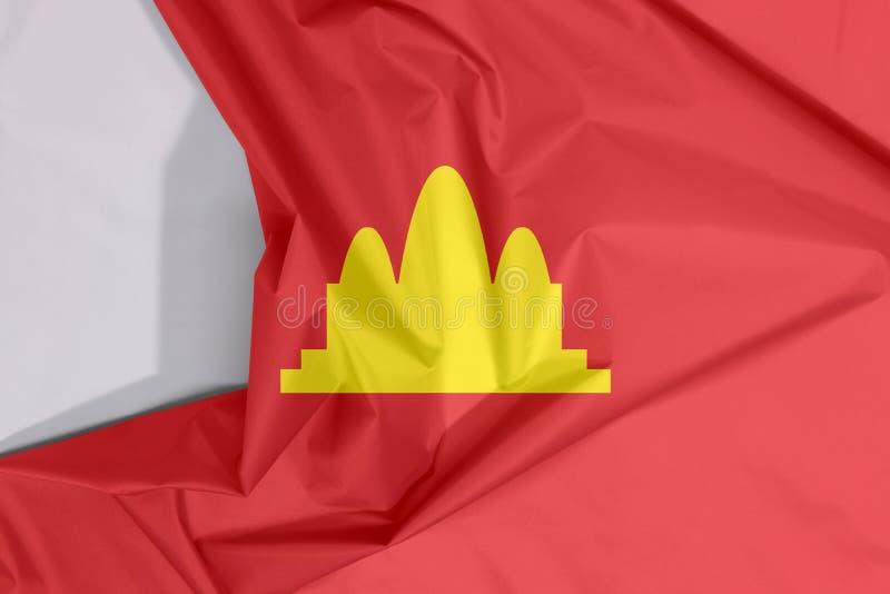 Crespón y pliegue de la bandera de Kampuchea Democrática de la tela con el espacio blanco imagen de archivo libre de regalías