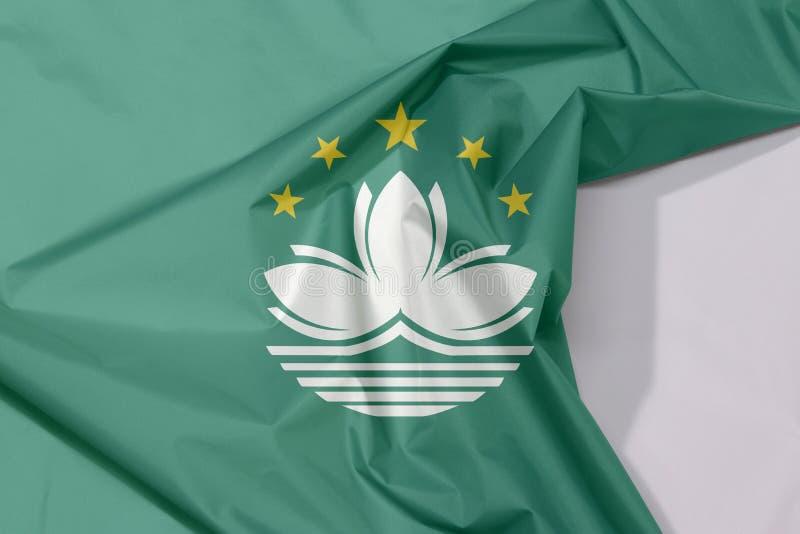 Crespón y pliegue de la bandera de la tela de Macao con el espacio blanco fotografía de archivo libre de regalías