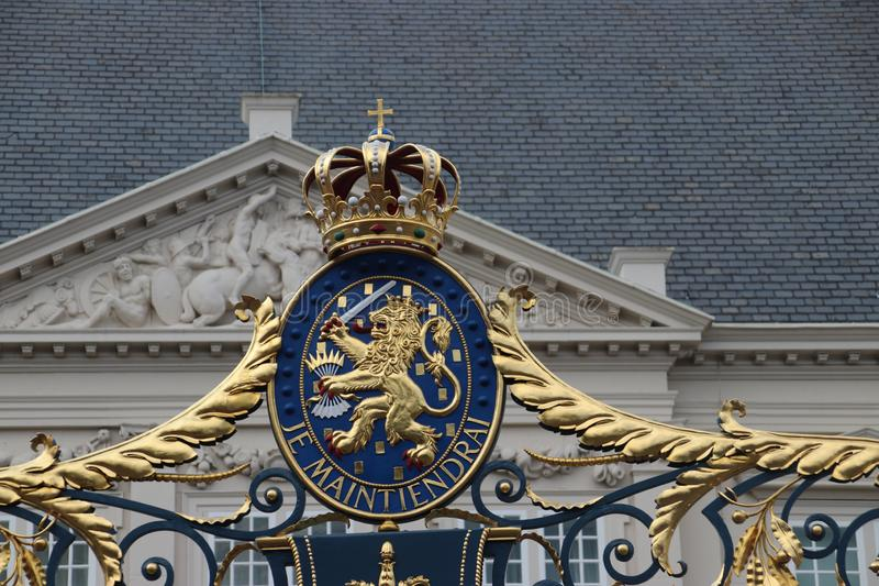 Crest of the Netherlands with text `Je maintiendrai ` I will enforce on fence of palace Noordeinde in The Hague in the Netherlan. Ds royalty free stock photo