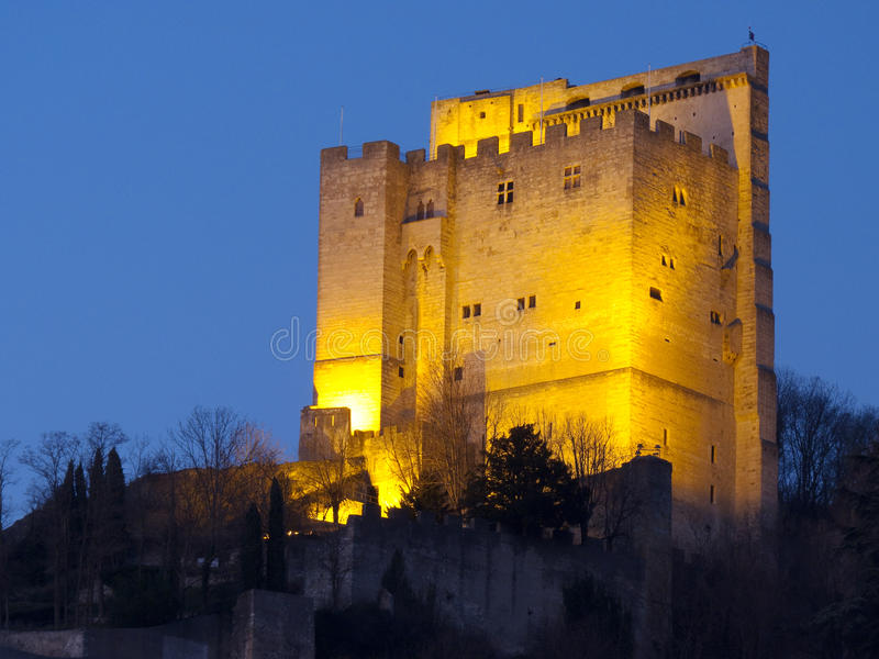 Crest tower by night. City of Crest, Drome, France royalty free stock photo