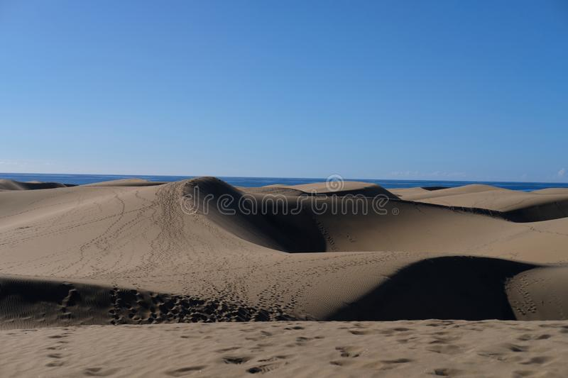 The crests of beautiful dunes and the deep shadows of Gran Canaria. stock image