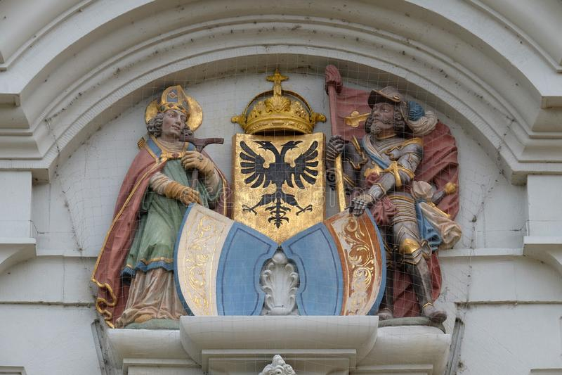 The crests of Lucerne and the Imperial Eagle flanked by St Leodegar and St Maurice, church of St. Leodegar in Lucerne stock photo