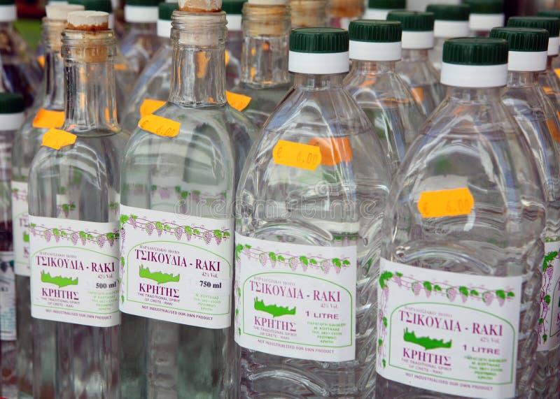 Cretan raki on sale. RETHYMNO, Crete, Greece - MAy 29, 2008: Bottles of raki, or tsikouthia, the traditional Cretan spirit, on sale in Rethymno royalty free stock photo