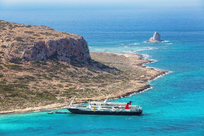 Crete coast, Balos bay, Greece. The ship is going on the marvelous turquoise sea. Popular touristic resort. Summer landscape. Crete coast, Balos bay, Greece royalty free stock photography