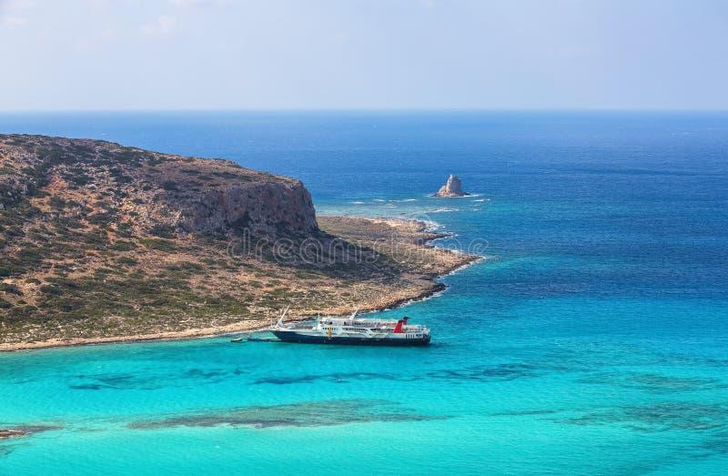 Crete coast, Balos bay, Greece. The ship is going on the marvelous turquoise sea. Popular touristic resort. Summer landscape. Crete coast, Balos bay, Greece royalty free stock image