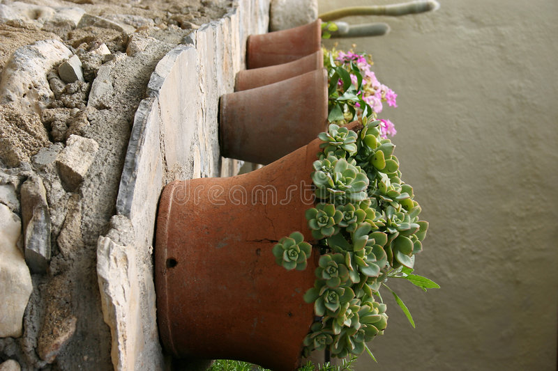 Crete / Flower pots on a wall. Some flower pots on a wall stock image