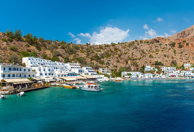 Pamoramic view on transparent blue lagoon and traditional greek houses near Loutro town, located at s stock photos