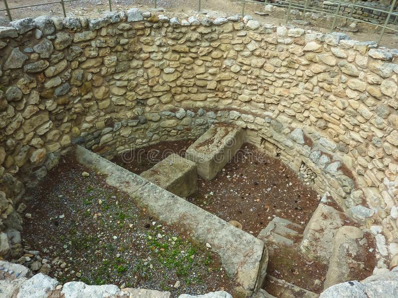 Crete, Greece - November, 2017: Pit for sacrifices, laid out with stones, the west courtyard of the Knossos palace. View from above. Knossos palace is the stock photo
