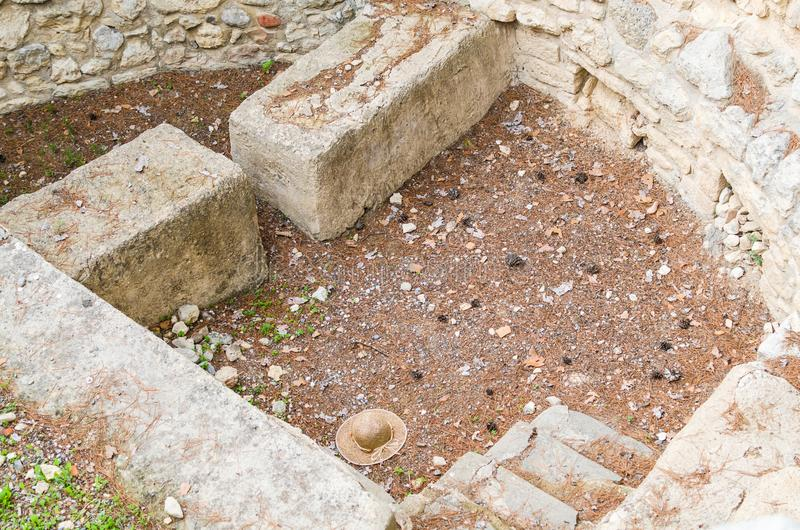 CRETE, GREECE - November, 2017: Pit for sacrifices, laid out with stones, the west courtyard of the Knossos palace. View from above. Knossos palace is the stock photos