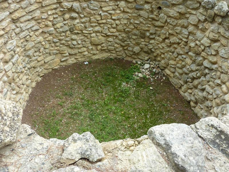Crete, Greece - November, 2017: Pit for sacrifices, laid out with stones, the west courtyard of the Knossos palace. View from above. Knossos palace is the royalty free stock images