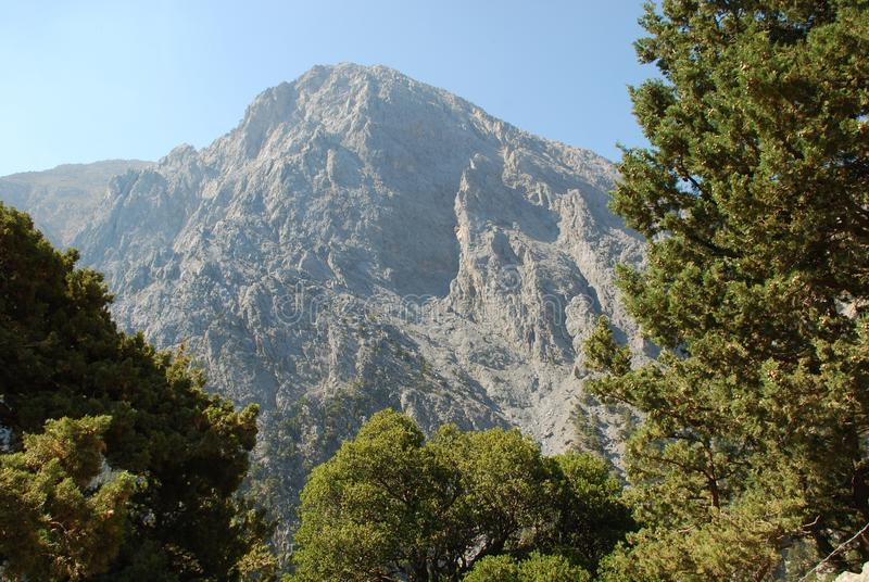 Crete, Samaria Gorge, very beautiful view of the mountains and small trees, stones, sand and hot sun stock image