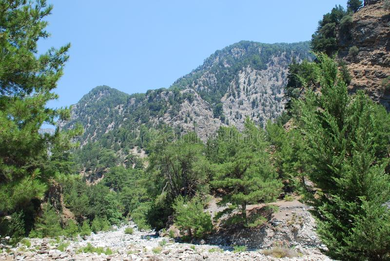 Crete, Samaria Gorge, very beautiful view of the mountains and small trees, stones, sand and hot sun. Crete, Samaria Gorge, very beautiful view of the mountains stock photo