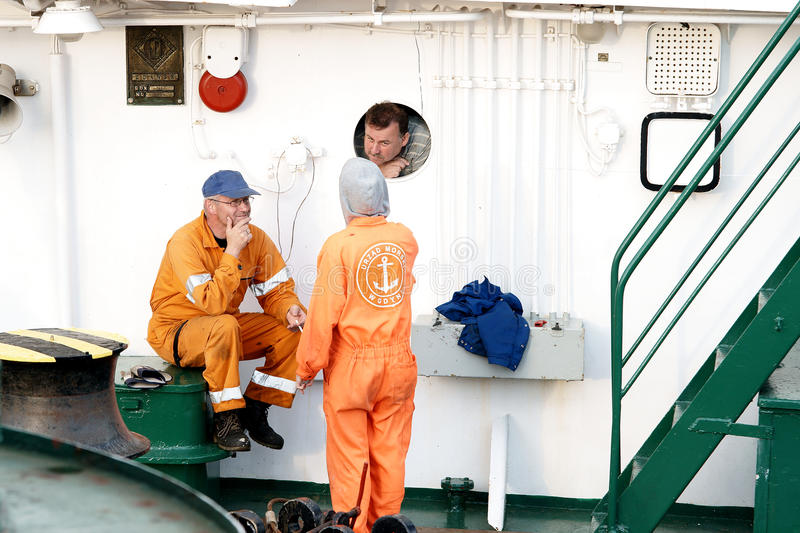 The crew during a break. Sailor's story during a break on board the Zodiac stock photography