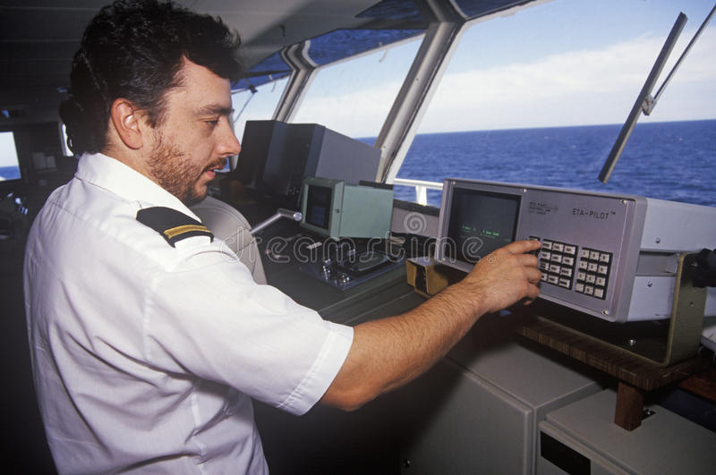 A crew member of the ferry Bluenose piloting the ship through the waters between Maine and Nova Scotia stock photos