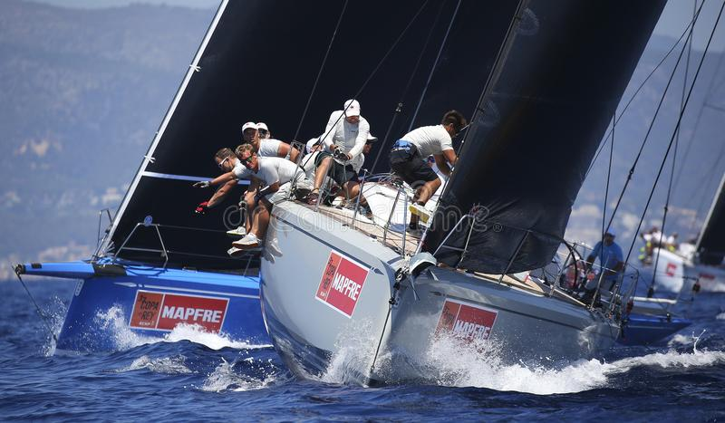 Crew at work during sailing regatta. The crew of a swan 50 class ship at work during the kings cup sailing regatta in the island of Mallorca