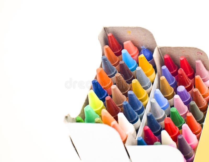 Creyones de cera coloridos en rectángulo imagen de archivo