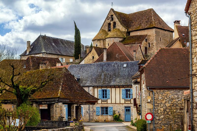 Creysse, a typical french village in Haut Quercy, Lot department, Martel, France. With traditional blue window shutters, brown brick buildings, tiled roofs and royalty free stock photos