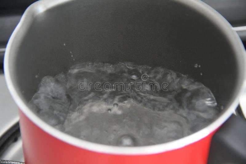Boiling water hot aluminium pan cooking recipe liquid Sao Paulo Brazil. Boiling water hot aluminium pan cooking recipe liquid n zil stock images