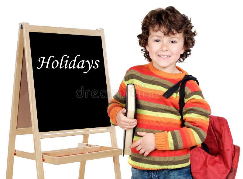 Criança adorável com ardósia fotografia de stock