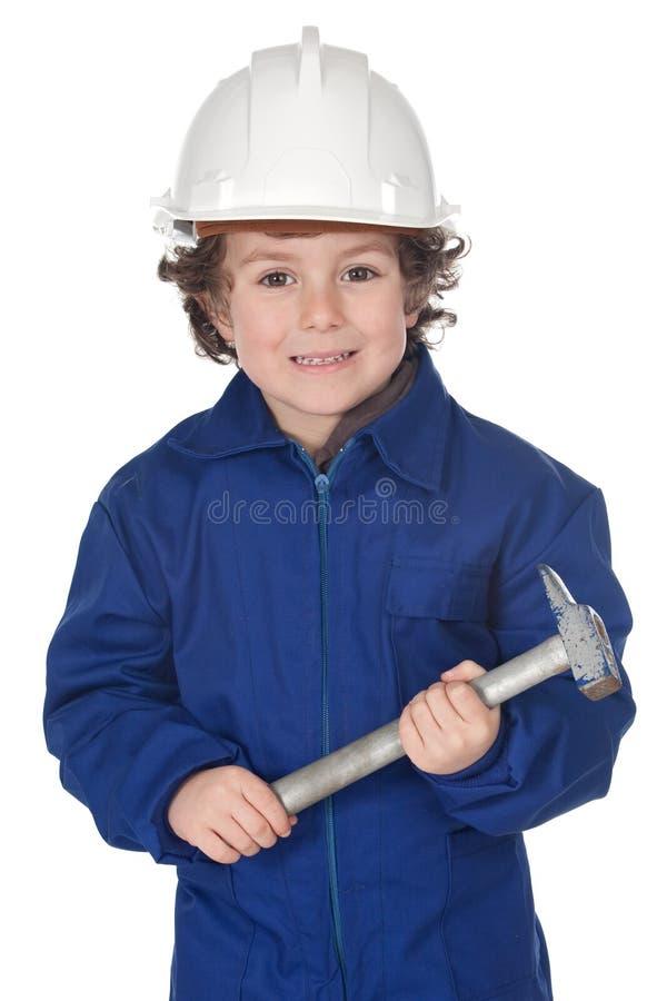 Criança adorável do trabalhador com um martelo imagens de stock
